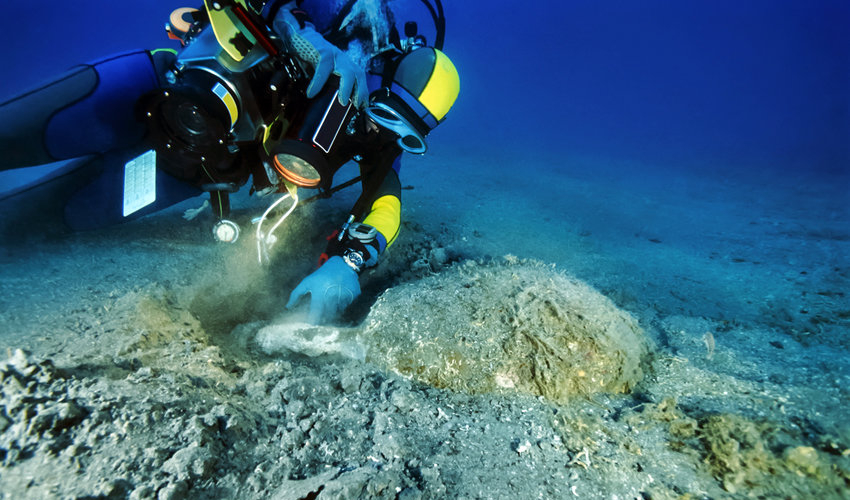 diver exploring underwater archaeological sites